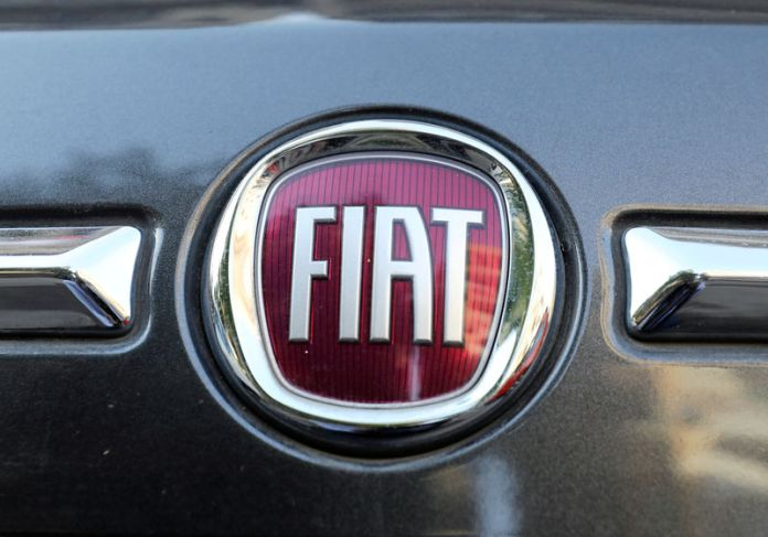 © -. FILE PHOTO: The logo of FIAT carmaker is seen on a vehicle in Cairo