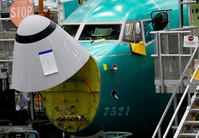 © -. The angle of attack sensor is seen on a 737 Max aircraft at the Boeing factory in Renton