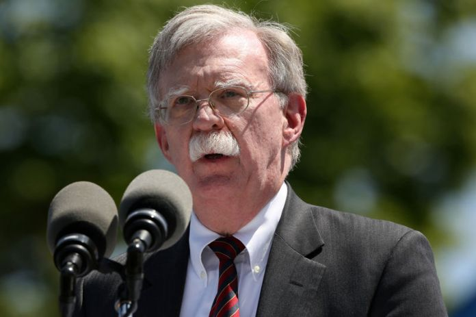 © -. U.S. National Security Advisor John Bolton speaks during a graduation ceremony at the U.S. Coast Guard Academy in New London