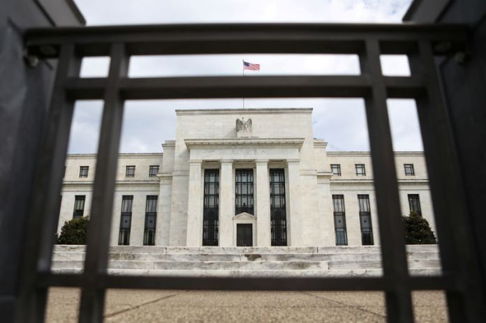 © -. FILE PHOTO: The Federal Reserve building is pictured in Washington, DC
