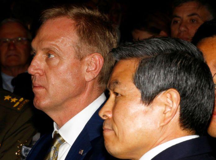© -. Acting U.S. Defense Minister Patrick Shanahan and South Korean National Defense Minister Jeong Kyeong-doo are seen at the IISS Shangri-la Dialogue in Singapore