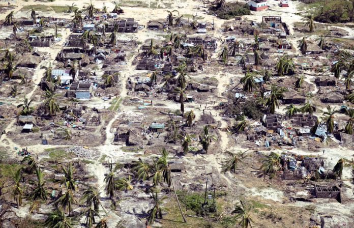 © -. Buildings damaged during Cyclone Kenneth are seen from the air in a village north of Pemba, Mozambique