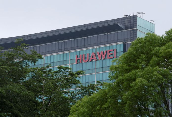 © -. FILE PHOTO: A Huawei logo is seen on the side of a building at the headquarters in Shenzhen