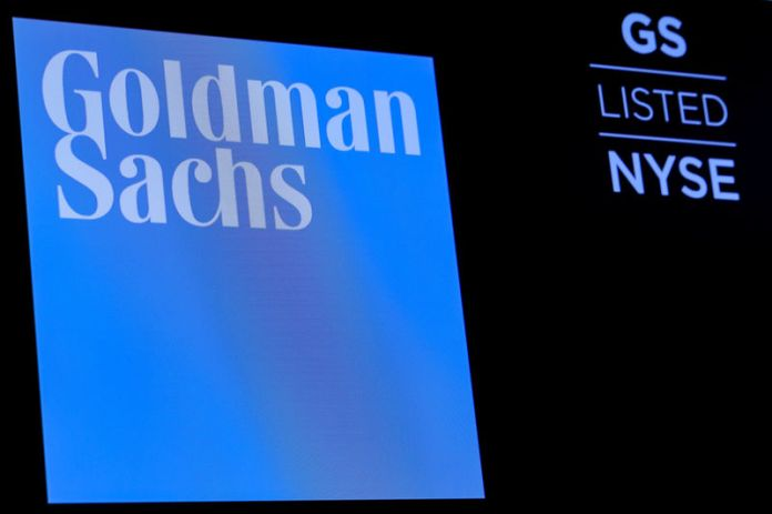 © -. FILE PHOTO: The ticker symbol and logo for Goldman Sachs on a screen on the floor at the NYSE in New York