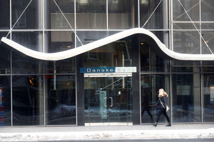© -. A woman walks past Danske Bank's Estonian branch in Tallinn