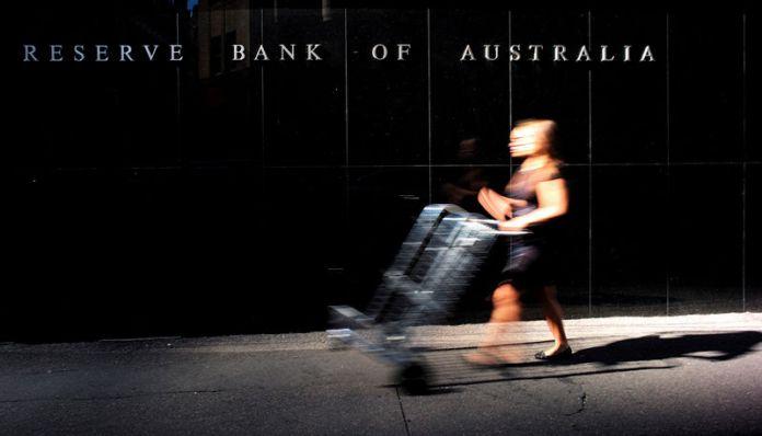 © -. FILE PHOTO: A goods deliverer walks past the Reserve Bank of Australia Building in Sydney's central business district