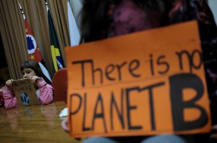 © -. School pupils protest to demand action, during the world march for climate change and the environment, called by the organization Fridays for Future inside of Secretary of State for the Environment in Sao Paulo