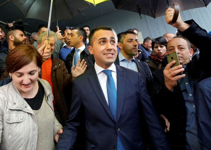 © -. FILE PHOTO: Italian Deputy Prime Minister and 5-Star Movement leader Luigi Di Maio leaves after casting his vote in the European election