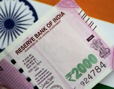 Indian rupee outlook worsens on trade war, growth risks: Reuters poll By Reuters