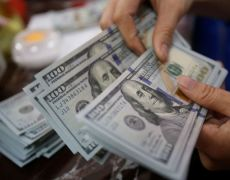 Dollar steady as market braces for U.S. jobs report By Reuters