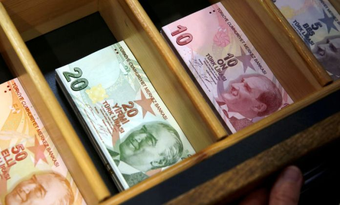 Turkish lira falls to 8.65 against the dollar ahead of a decision on interest