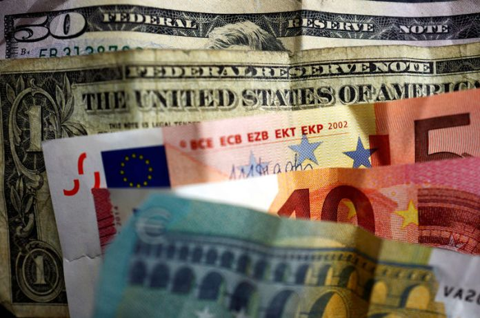Dollar Edges Down From 13-Month High Ahead of CPI Data