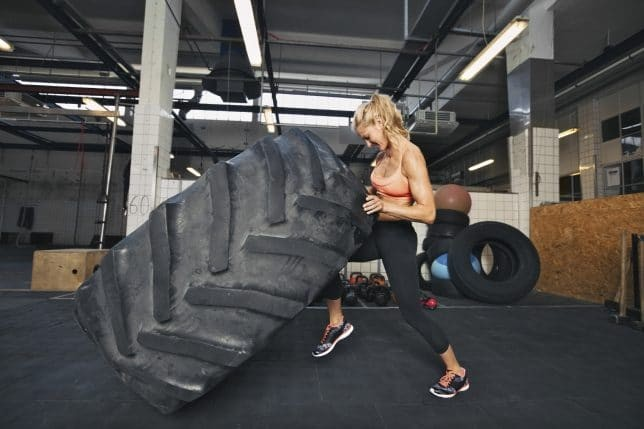 Young Woman Flipping Tire At Gym 000040912896 Medium 644x429
