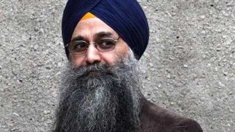 Inderjit Singh Reyat walks outside B.C. Supreme Court in Vancouver on Sept. 10, 2010.