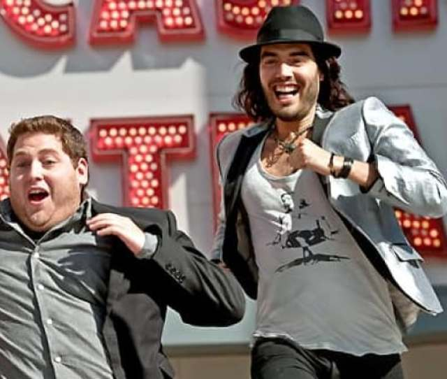 Aaron Jonah Hill Left And Aldous Russell Brand Escape A Las Vegas Party Gone Berserk In A Scene From The Music Biz Comedy Get Him To The Greek
