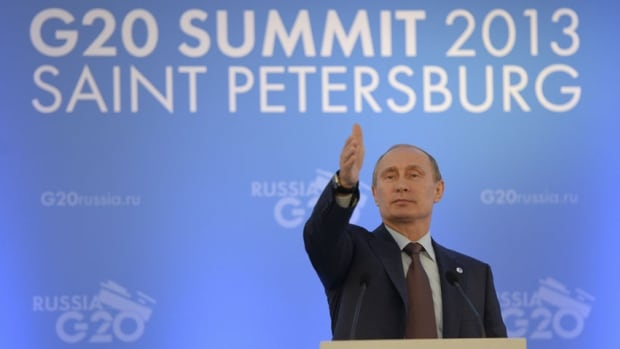 Russian President Vladimir Putin speaks to the media during a news conference at the G20 summit in St. Petersburg on Sept. 6, 2013. The Kremlin is denying a report that spy devices were distributed as gifts at the summit.