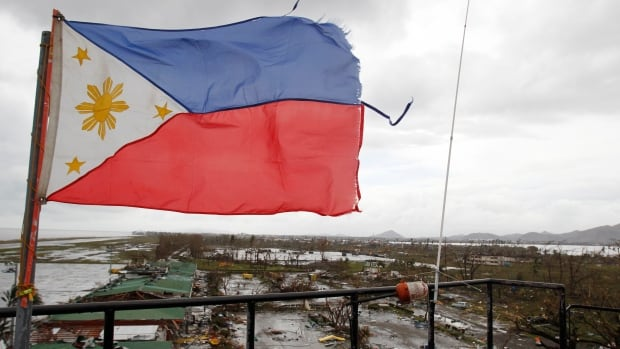 A Philippine flag flutters atop the control tower of a damaged airport after super Typhoon Haiyan battered Tacloban city, in the central Philippines. Haiyan is possibly the strongest typhoon ever to hit land.