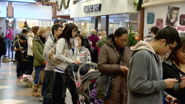 Calgarians line up at the Brentwood Mall for flu shots. Health experts say even if you had the vaccine during the 2009 H1N1 pandemic, you should get immunized again.