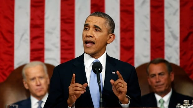 U.S. President Barack Obama delivers the state of the union address before a joint session of Congress in the House chamber Tuesday as Vice-President Joe Biden and House Speaker John Boehner listen.