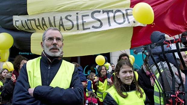 Belgian protestors on Sunday stand in front of a banner which reads 'Euthanasia Stop' during an anti-euthanasia demonstration in Brussels. In a vote, Belgian lawmakers on Thursday approved extending euthanasia to children.