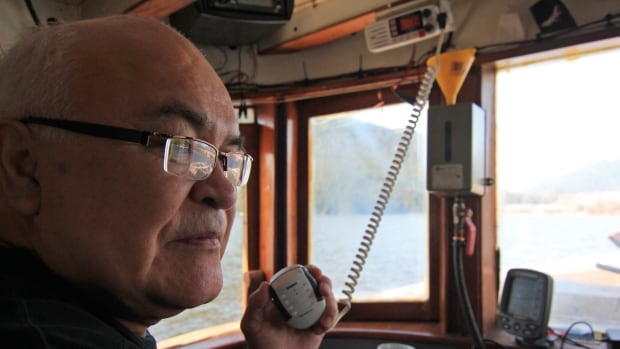 Gerald Amos talks on the radio in his boat, while out on the waters of the Douglas Channel in northern British Columbia on April 13, 2014. He's just a few miles away from where Enbridge Inc. plans to build its Northern Gateway pipeline terminal facility for its oil pipeline carrying diluted bitumen 1,177 km (731 miles) from Alberta's oilsands.