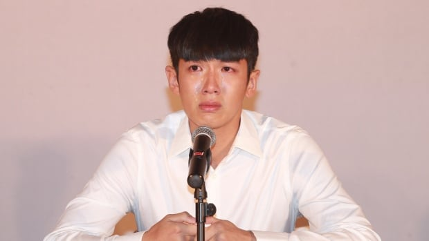 Taiwanese movie star Kai Ko, cries during a press conference Friday after two weeks in detention. The 23-year-old was arrested on drug charges with Jaycee Chan, the son of martial arts superstar Jackie Chan.