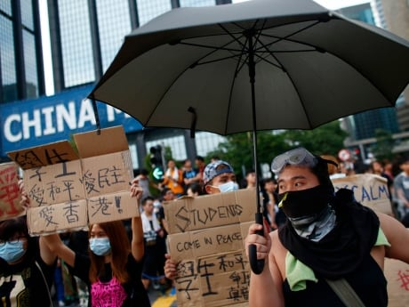 Protesters gather around the Golden Bauhinia Square, Hong Kong on Wednesday. Pro-democracy protest leaders in Hong Kong warned that if the territory's leader doesn't resign by the end of Thursday they will step up their actions, including occupying important government buildings.
