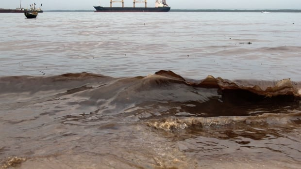 Crude oil washes up near the shore after a Shell pipeline leaked, in the Nigerian delta region on Nov. 27. Niger Delta fishermen are no strangers to seeing oil spill into their waters from leaky pipelines.