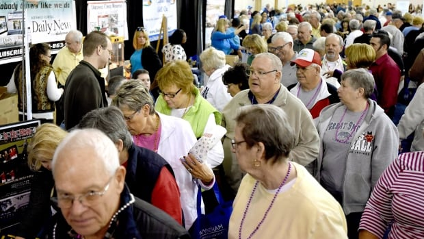 Rules changes may happen that will affect U.S.-bound Canadian snowbirds. A crowd of snowbirds visit the Winter Guest Fest in Fort Walton Beach, Fla. on Jan. 16.
