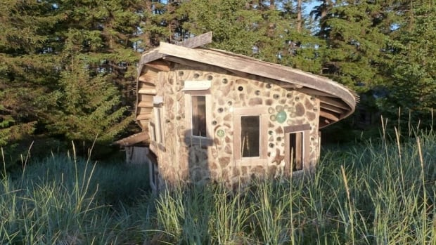 This tiny house (about 180 square feet) is made of cordwood, driftwood and bottles built up with mortar, a technique known as stackwall. It was designed and built by Netonia Yalte.
