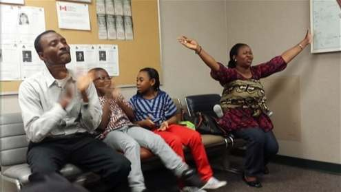 Dimeji and Deborah Tawose and their children, who were about to be forced out of the country, celebrate upon hearing that they have been granted one-year reprieve to sort out their immigration paperwork.