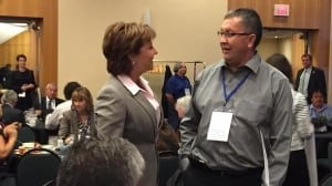 Premier Christy Clark greets Chief Fred Sam of the Nak'azdli First Nation on Wednesday as the meeting gets underway.