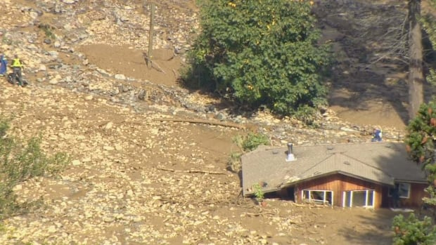 A two-storey house in Birken, north of Pemberton, was buried up to its roof line after a mudslide Sunday.