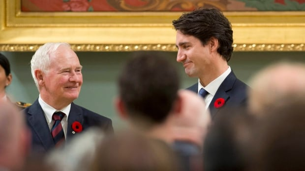 Prime Minister Justin Trudeau, right, stands with Gov. Gen. David Johnston after being sworn in as prime minister at Rideau Hall in Ottawa Nov. 4.