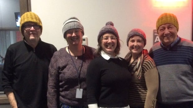Wenda MacDonald and Helen Langille sport toques they've knitted with Louise Renault (centre), Don Connolly (far left) and Peter Coade (far right) of CBC Halifax's Information Morning.