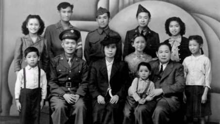 A 1946 photograph of Wong Kung Lai (bottom, second from right) with his children, and brother-in-law Chu (bottom, in uniform) who introduced him to his wife.