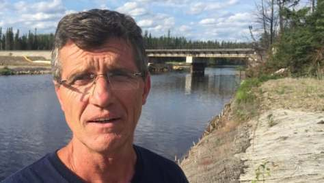 Gogama Fire Chief Mike Benson stands by the bridge over the Makami River where an oil train burst into flames in March 2015.