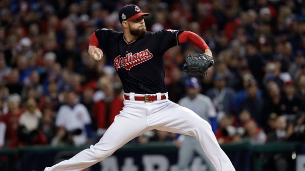 Corey Kluber pitched neatly into the seventh inning, Roberto Perez hit two home runs and the Cleveland Indians beat the Chicago Cubs 6-0 Tuesday night in the World Series opener.