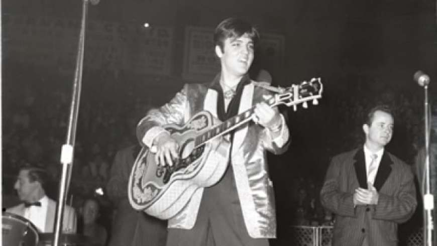 Elvis Presley performs at the Ottawa Auditorium on April 3, 1957.