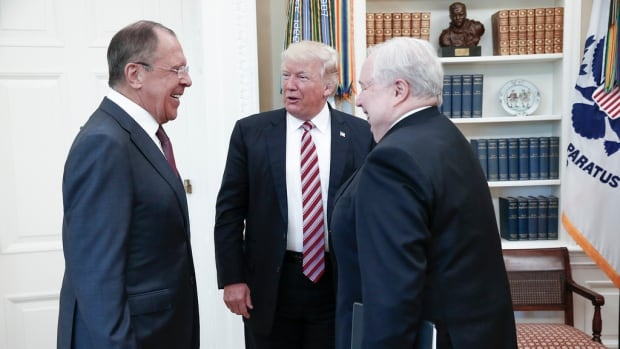 U.S. President Donald Trump speaks with Russian Foreign Minister Sergei Lavrov, left, and Russian Ambassador to the U.S. Sergei Kislyak at the White House on May 10. On Tuesday, after it was reported Trump revealed highly classified information, he tweeted he shared info for 'humanitarian reasons, plus I want Russia to greatly step up their fight against ISIS & terrorism.'