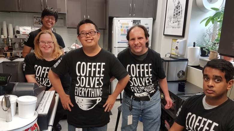 Employees at the Coffee Shed's Surrey Place Centre location, from back left to front right: Mimi Yickman Yiu, Rachel Boardman, Paul Wong, Alexander Saab, Andrew Mathew.
