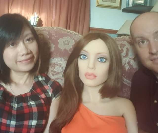 Arran Lee Squire Right And His Wife Pose With Their Sex Robot Samantha Submitted By Arran Lee Squire