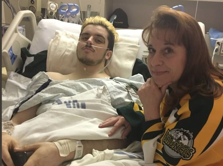 Paralyzed Broncos player, parents want seatbelts on buses ryan and michelle straschnitzki