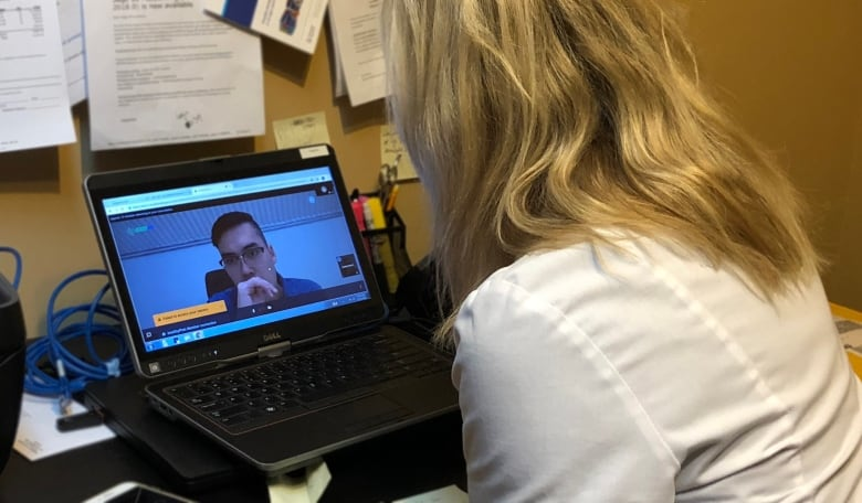 doctor vet teleconferencing with patient