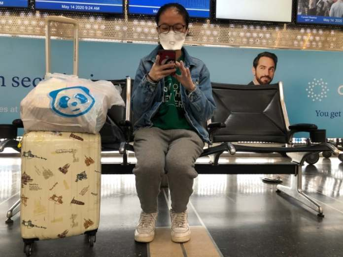 Robots and electrostatic sprayers: Air travel industry looks to technology to bring back wary passengers   CBC News