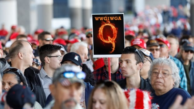 Twitter says it will crack down on tweets involving conspiracy theory group QAnon | CBC News