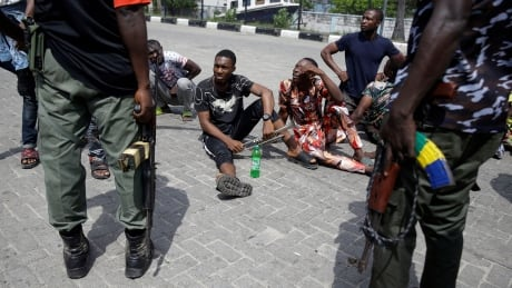 Nigeria says dozens dead in unrest over police brutality