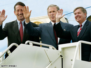 President Bush with Sanford, left, and Graham, right.
