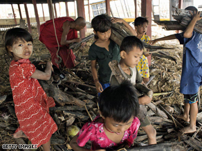 Children help out clearing debris from under the monastery May 10, 2008 in the village of Kyaun Da Min a few hours south of Pyapon, Myanmar.