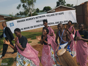 People sing and dance outside the Rwanda Women's Network Centre in Kigali in January 2007.
